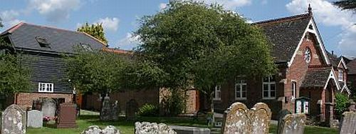 View of Slinfold Village Hall (including new extension) from churchyard
